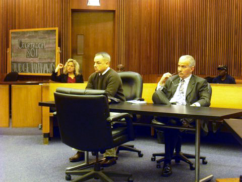 Detroit Police Officer Joseph Weekley is seen seated with his attorney, Steve Fishman. (credit: WWJ/Pat Sweeting, File)