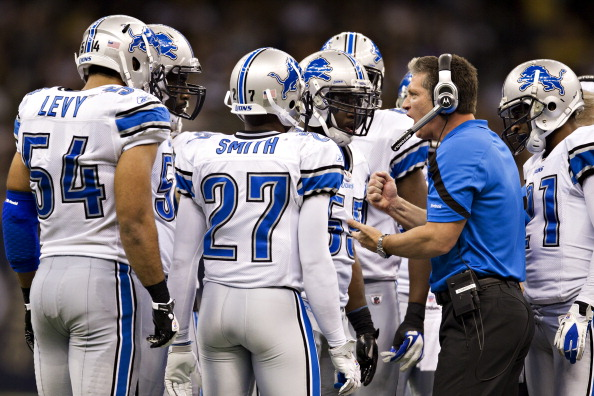 NEW ORLEANS, LA - DECEMBER 4: Head Coach Jim Schwartz of the Detroit Lions talks with his team during a game against the New Orleans Saints to score a touchdown at Mercedes-Benz Superdome on December 4, 2011 in New Orleans, Louisiana. The Saints defeated the Lions 31-17. (Photo by Wesley Hitt/Getty Images)