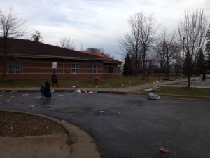 Garbage litters the ground at a human services building in Taylor where thousands of people rioted when a Section 8 Housing Choice Voucher distribution event was cancelled. (WWJ Photo/Beth Fisher)