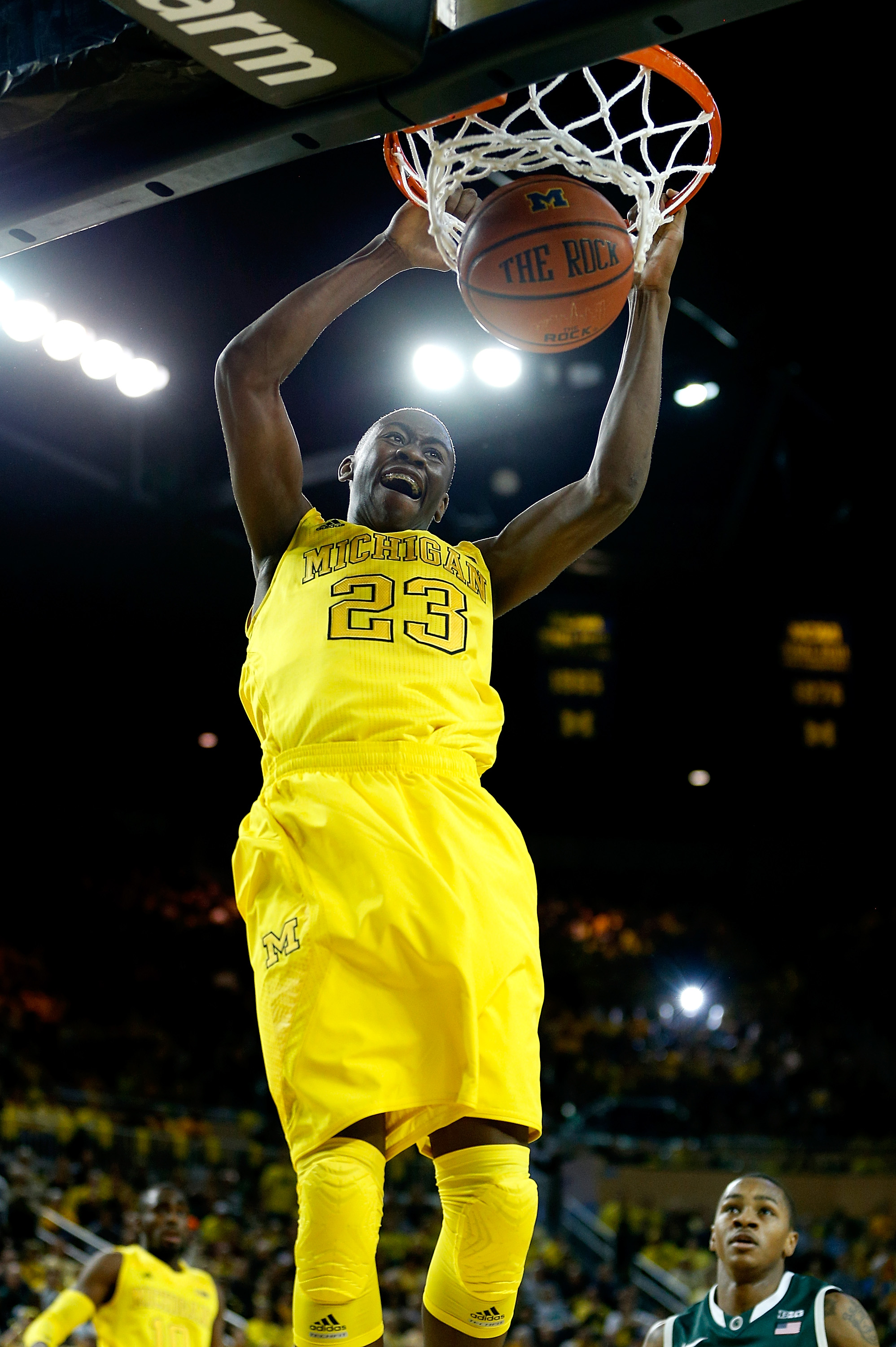 ANN ARBOR, MI - MARCH 03: Caris LeVert #23 of the Michigan Wolverines gets in for a first half dunk while playing the Michigan State Spartans at Crisler Center on March 3, 2013 in Ann Arbor, Michigan. (Photo by Gregory Shamus/Getty Images)