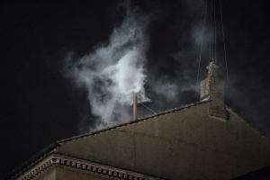 White smoke rises from the chimney on the roof of the Sistine Chapel meaning that cardinals elected a new pope on the second day of their secret conclave on March 13, 2013 at the Vatican. (credit: ALBERTO PIZZOLI/AFP/Getty Images)