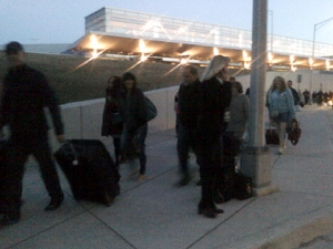 Delayed passengers make their way to the Smith Terminal. (credit: Mike Campbell/WWJ)
