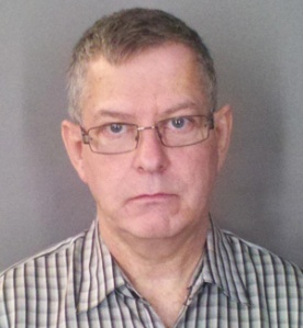 Bookkeeper George Bauer is charged with helping a non-profit company's CEO embezzle money for the sake of getting his own cut. (Photo: Michigan Attorney General's Office)