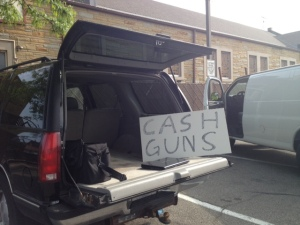 An alternative cash for guns program set up outside the church.
