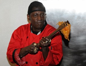 Rapper Flavor Flav cooks chicken during the official grand opening of his Flavor Flav House of Flavor Take Out Restaurant on March 15, 2012 in Las Vegas, Nevada. (Credit: Ethan Miller/Getty Images)