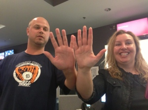Evan Jankens and Christy Strawser compare hand sizes.
