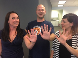 Beth Ayers, Evan Jankens and Gabrielle Jacobson compare hand sizes.