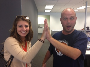 Katelynn Pickelhaupt and Evan Jankens compare hand sizes.