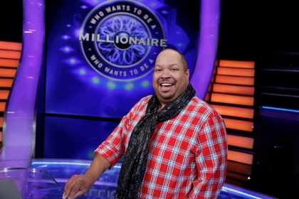 Terrill Sanford from Southfield, Mich. is the first contestant on WHO WANTS TO BE A MILLIONAIRE with Cedric The Entertainer. (Disney-ABC/Heidi Gutman)