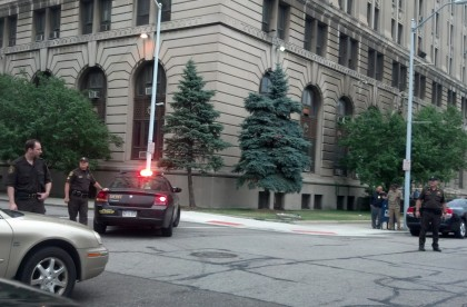 Authorities are seen outside the Frank Murphy Hall of Justice following a prisoner escape.(credit: Ron Dewey/WWJ)