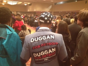 A Duggan supporter in the crowd gathered viewing results in Detroit's mayoral election. (WWJ/Vickie Thomas)