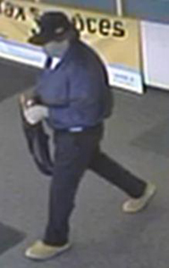 Taylor Police are trying to identify the man on suspicion of having shot and killed an employee of a cash advance store.