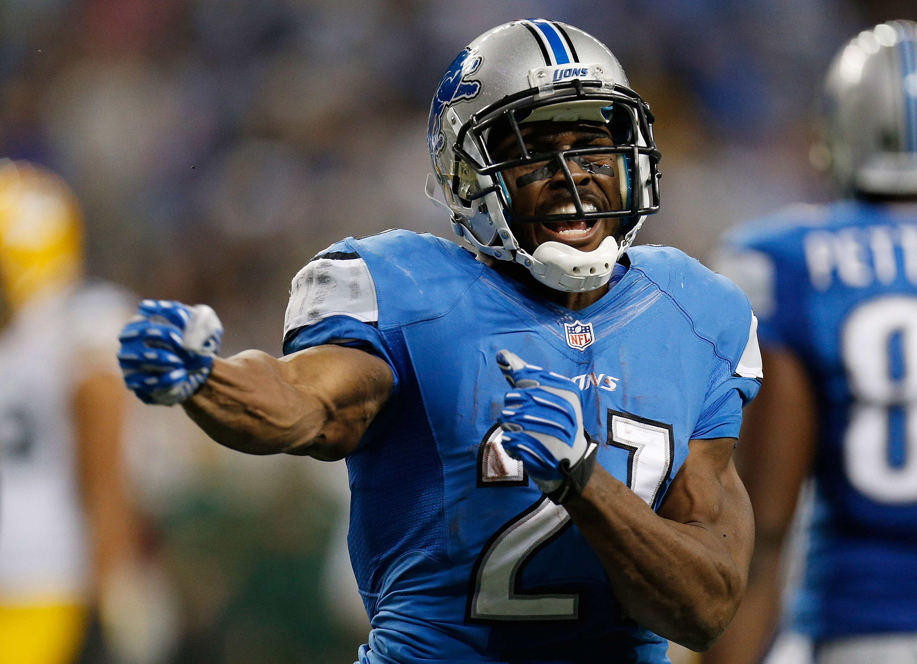 DETROIT, MI - NOVEMBER 28: Reggie Bush #21 of the Detroit Lions reacts after a second quarter reception and long run while playing the Green Bay Packers at Ford Field on November 28, 2013 in Detroit, Michigan. (Photo by Gregory Shamus/Getty Images)