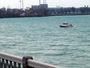 Fearing someone might have jumped into the water, the U.S. Coast Guard searches the Detroit River after someone found clothing on the Belle Isle bridge. (Credit Mike Campbell/WWJ Newsradio 950)