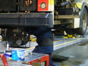 D-DOT mechanic works on city bus. (photo credit: Pat Sweeting/WWJ Newsradio 950)