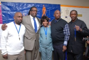 L)Travis Williams,  Andre Johnson of the  DRP,  Jennifer Jones, Marcus Kelly and Michael Berry all received keys to a new apartment in Highland Park. (Credit/Joseph Howse)