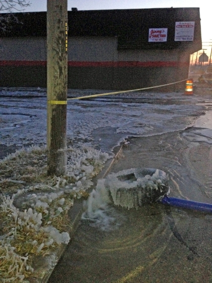 Water continues to freeze and flood Detroit streets the day after a massive water main break. (Credit: Charlie  Langton/WWJ Newsradio 950)