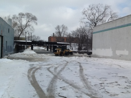 A backhoe works to move ice in flooded Southwest Detroit. (credit: Marie Osborne/WWJ)