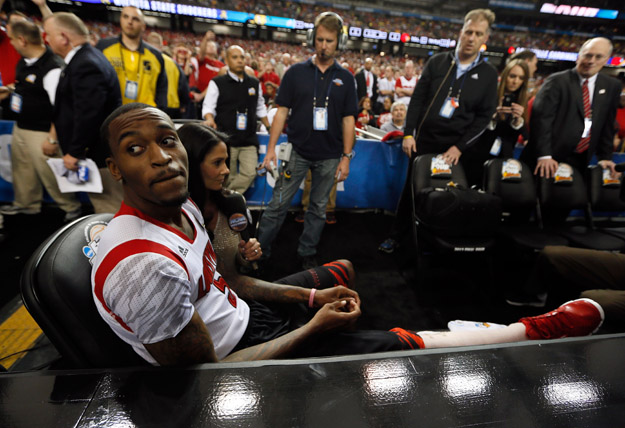 ATLANTA, GA - APRIL 06:  Injured Louisville Cardinals player Kevin Ware #5 sits on the bench as he waits to be interviewed by CBS Sports reporter Tracy Wolfson before the Cardinals take on the Wichita State Shockers in the 2013 NCAA Men's Final Four Semifinal at the Georgia Dome on April 6, 2013 in Atlanta, Georgia.
