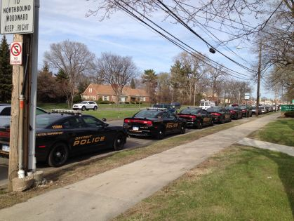 Detroit Police cars line the curb as far as the eye can see just prior to a massive raid operation on the city's west side. (Credit: Sandra McNeill/WWJ Newsradio 950)