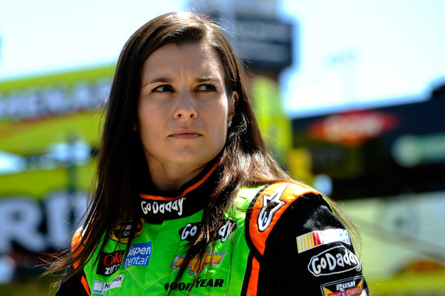 KANSAS CITY, KS - MAY 09:  Danica Patrick, driver of the #10 GoDaddy Chevrolet, stands in the garage area during practice for the NASCAR Sprint Cup Series 5-Hour Energy 400 at Kansas Speedway on May 9, 2014 in Kansas City, Kansas.