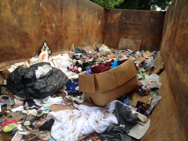 Police recovered potential evidence from this dumpster in Dearborn while investigating the murder of a Detroit woman, Alicia Fox. (Credit: Mike Campbell/WWJ Newsradio 950)