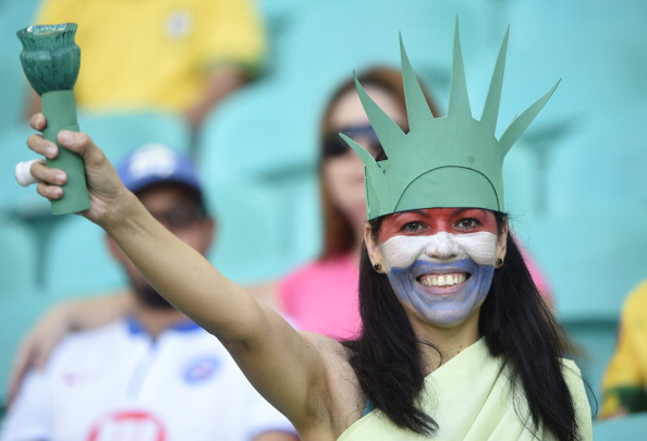 USA's fan cheers before a Round of 16 football match between Belgium and USA (credit: MARTIN BUREAU/AFP/Getty Images)