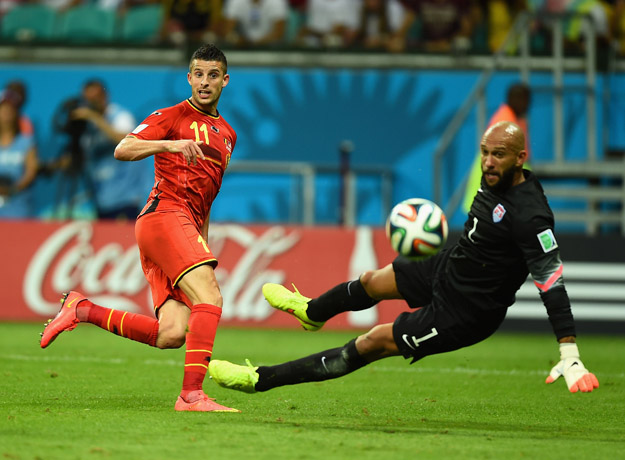 SALVADOR, BRAZIL - JULY 01:  Kevin Mirallas  of Belgium has his shot saved by Tim Howard of the United States during the 2014 FIFA World Cup Brazil Round of 16 match between Belgium and the United States at Arena Fonte Nova on July 1, 2014 in Salvador, Brazil.