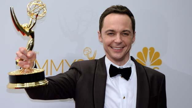 """Jim Parsons poses in the press room after winning the Outstanding Lead Actor in a Comedy Series Award for The Big Bang Theory (Episode: """"The Relationship Diremption"""") during the 66th Emmy Awards (Photo credit MARK RALSTON/AFP/Getty Images)"""