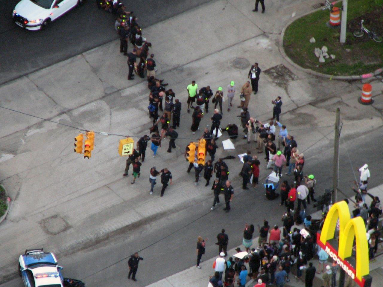 Dozens of people were arrested during a minimum wage protest outside a Detroit McDonald's. (Credit: Bill Szumanski/WWJ Newsradio 950)