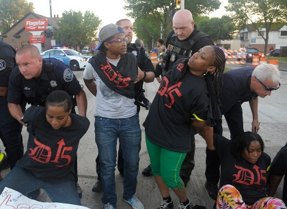 Dozens of people were arrested during a minimum wage protest outside a Detroit McDonald's. (Credit: Darci E. McConnell/D15 campaign)