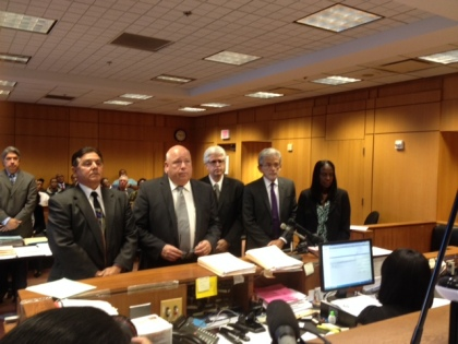 Standing in court with their attorneys, three people are arraigned on charges connected to the failed Wayne County Jail project. (Credit: Mike Campbell/WWJ Newsradio 950)