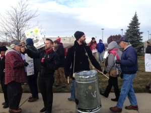 Protesters demonstrate outside of a Walmart in Sterling Heights (Photo: Vickie Thomas/WWJ)