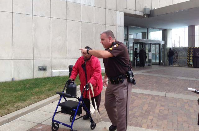 An officer assists a women who was evacuated from the City-County building. (credit: Vickie Thomas/WWJ)
