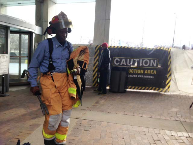 A firefighter exits the City-County building after assisting in the evacuation. (credit: Vickie Thomas/WWJ)