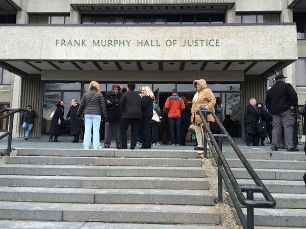 People wait outside after the Frank Murphy Hall of Justice is evacuated due to a power outage. (credit: Marie Osborne/WWJ)