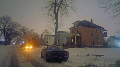 Michigan State Police officers sit outside of the home where a Highland Park officer was shot during a police raid, (Credit: Mike Campbell/WWJ Newsradio 950)