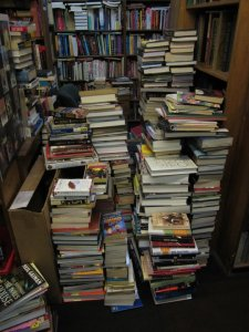 The West Side Book Shop has piles and piles of gently-used books to choose from. (credit: Michael Ferro)