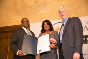 """Hiram Jackson, CEO of Real Times Media and publisher of the Michigan Chronicle, with Gov. Rick Snyder, and Cathy Nedd, COO of the Chronicle, during """"Pancakes and Politics"""" Thursday at the DAC. Snyder presented a proclamation to them to celebrate the 10th anniversary season of the iconic sprint time speakers series. (credit: Monica Morgan)"""