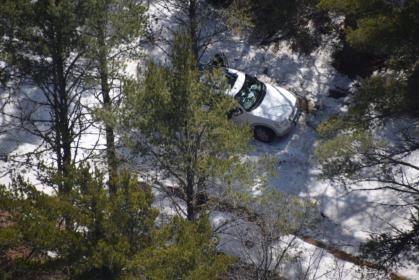 Helicopters spot the missing women's vehicle through the forest. (Credit: Michigan State Police)