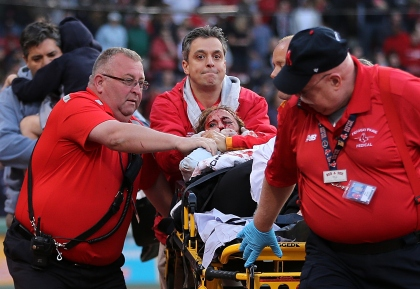 BOSTON, MA - JUNE 5: A fan is attended to by medical staff after she was hit by a broken bat during a game between the Boston Red Sox and the Oakland Athletics in the second inning at Fenway Park on June 5, 2015 in Boston, Massachusetts.  (Photo by Jim Rogash/Getty Images)