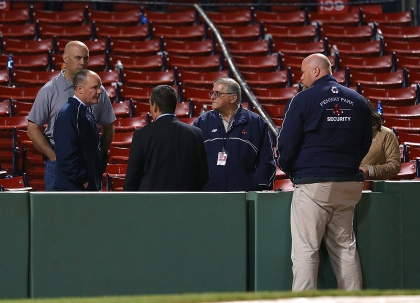 BOSTON, MA - JUNE 5: People gather where a woman was seriously injured by a broken base bat during a game between the Boston Red Sox and the Oakland Athletics at Fenway Park on June 5, 2015 in Boston, Massachusetts. (Photo by Jim Rogash/Getty Images)