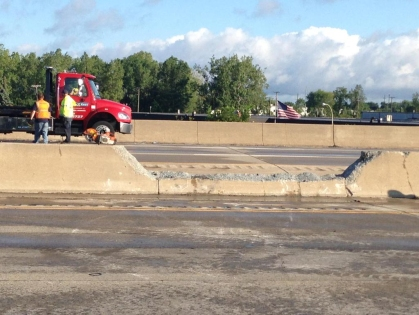 A hole left in the median of I-75 after a tanker truck overturned and caught fire. (Credit: Charlie Langton/WWJ Newsradio 950)
