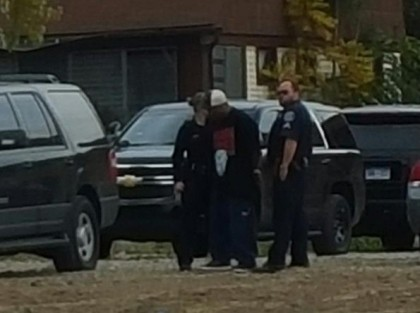 A barricaded gunman is taken into custody. (credit: Mike Campbell/WWJ)