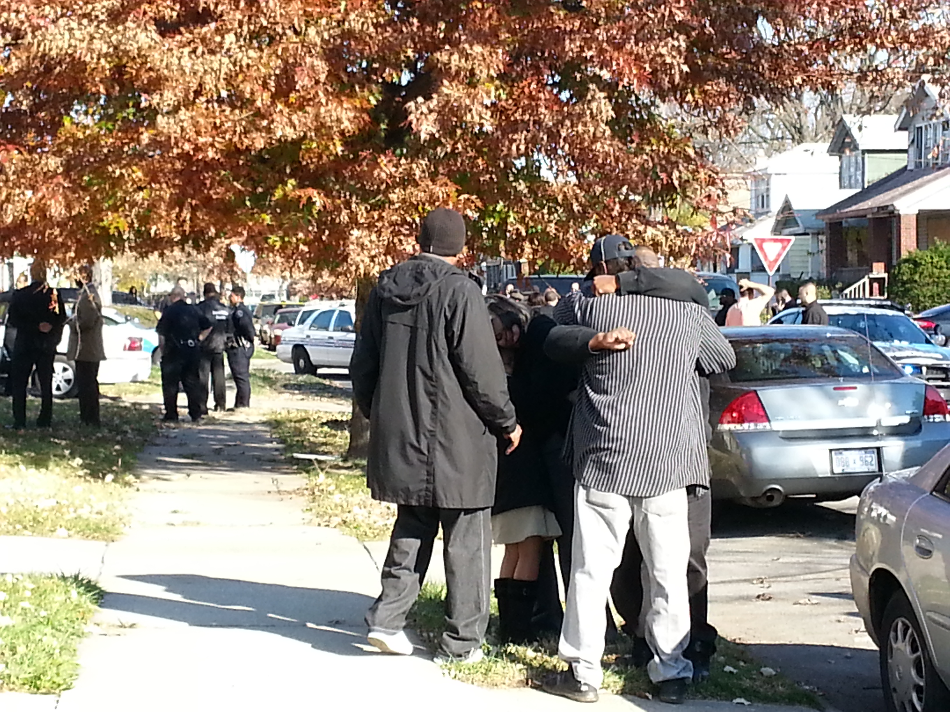 Family members hug after a 9-year-old boy was killed while playing with a gun. (credit: Jon Hewett/WWJ)