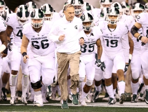 INDIANAPOLIS, IN - DECEMBER 05: Head coach Mark Dantonio of the Michigan State Spartans leads his team onto the field before the game against the Iowa Hawkeyes in the Big Ten Championship at Lucas Oil Stadium on December 5, 2015 in Indianapolis, Indiana. (Photo by Andy Lyons/Getty Images)