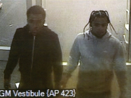 Police are looking to identify these suspects, wanted in a fraud investigation. (police handout)