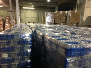 Bottled water is loaded into a warehouse in Flint before delivery to residents. (WWJ/Vickie Thomas)