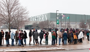 YPSILANTI, MI - FEBRUARY 15: People wait in line in the cold to get into U.S. Senator and Democratic Presidential Candidate Bernie Sanders (I-VT) first campaign rally in Michigan at Eastern Michigan University February 15, 2016 in Ypsilanti, Michigan. Sanders is expected to speak on a wide range of issues, including his plans to make public colleges and universities tuition-free. The next voting for the democratic candidates will be the Democratic caucus in Nevada on February 20. (Photo by Bill Pugliano/Getty Images)