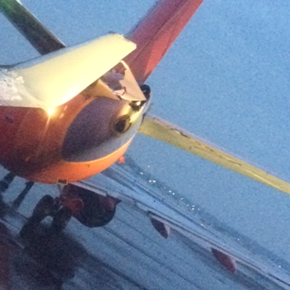 Passenger Jim Bishop captured this photo after two planes collided at Detroit Metro Airport. (Credit: Jim Bishop)